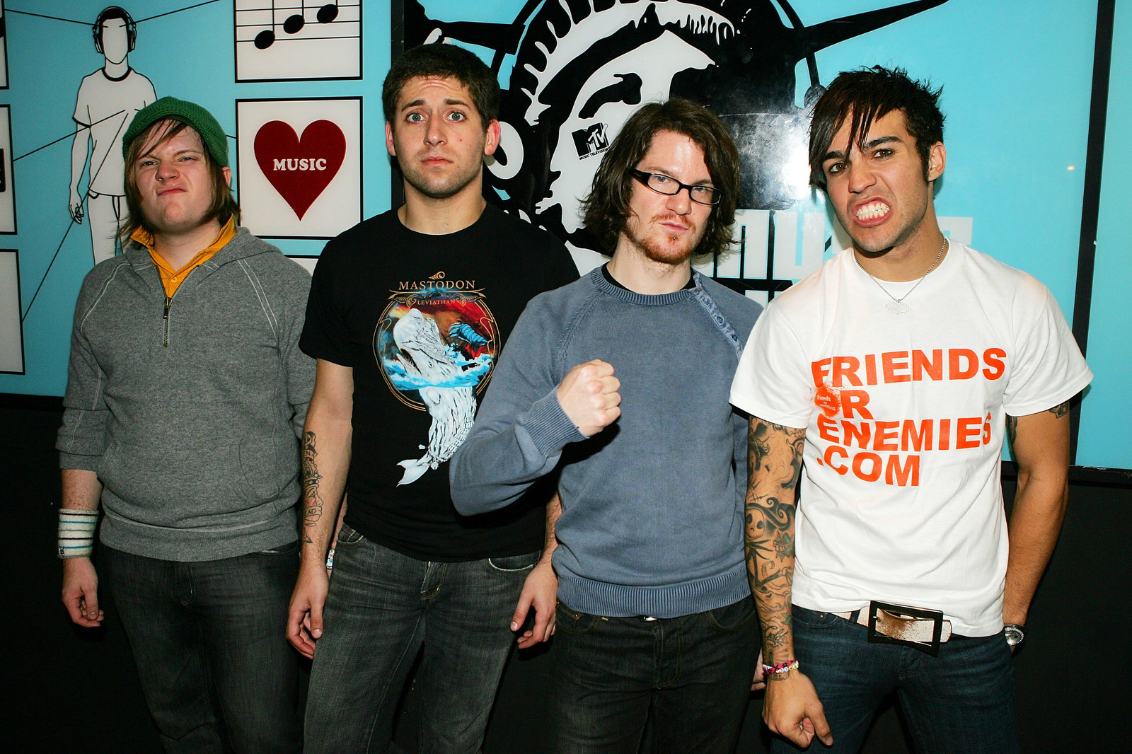 """Seriously, the glow-up of this band is astounding. Here's Fall Out Boy in 2005, at the HEIGHT of all things emo, looking very, """"I'll tell you that I'll have your daughter home by 10p.m., but really we're going to sneak in through her back window at 2a.m."""": -  This ain't a scene it's a DAMN FUNNY FACE RACE."""