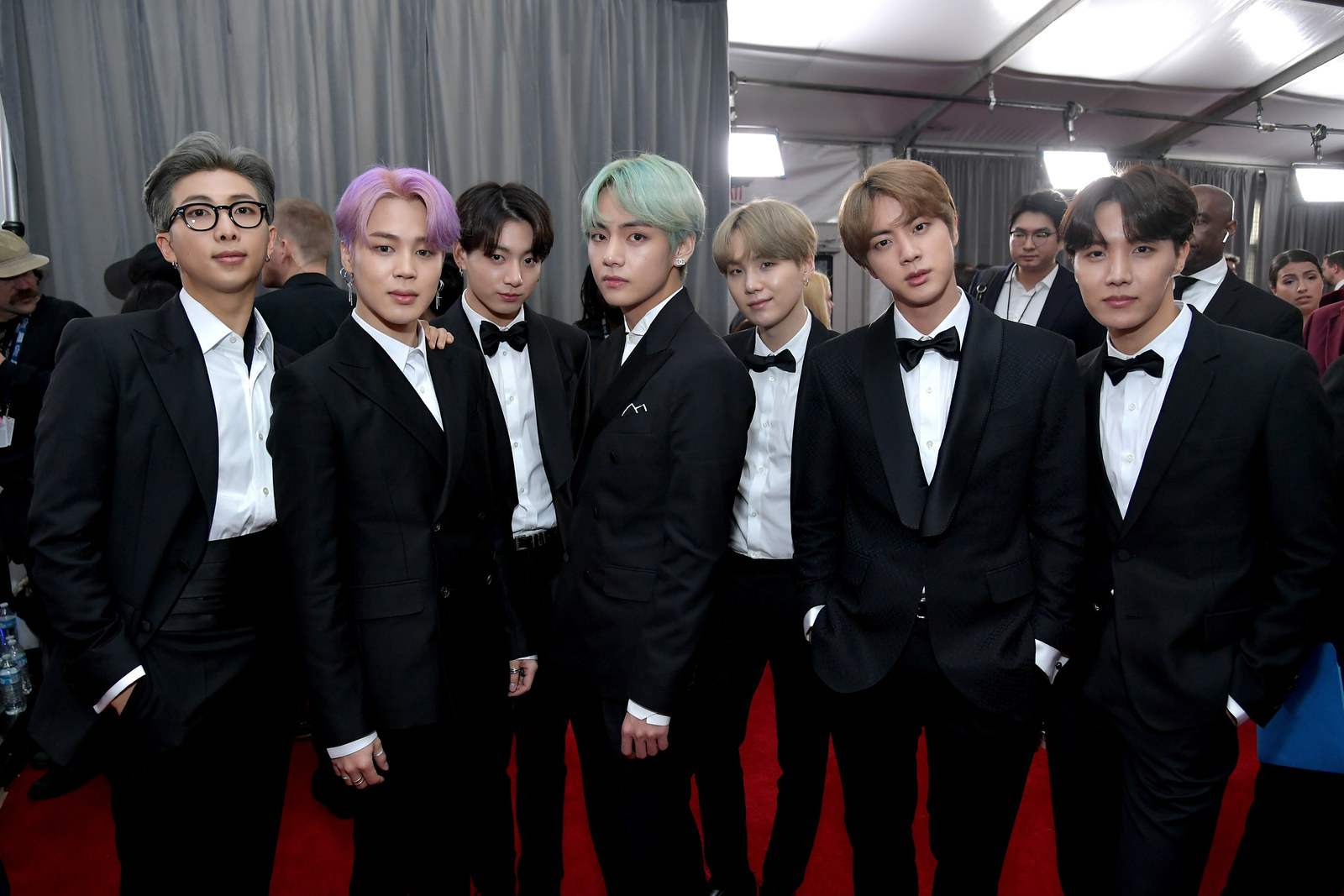 Everyone's hair looks amazing and perfectly swept across their foreheads (or pushed back, in RM's case), but OMG that mint, lavender, and smoky gray are to die for.Also, Jin's cocked expression is too good.