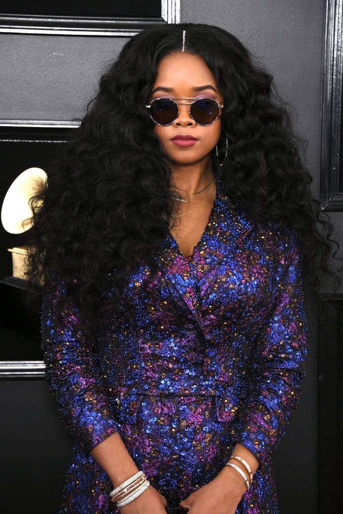 I do spy a bit of shimmery purple eyeshadow, and along with her matte purple lip, the whole ensemble just WORKS.