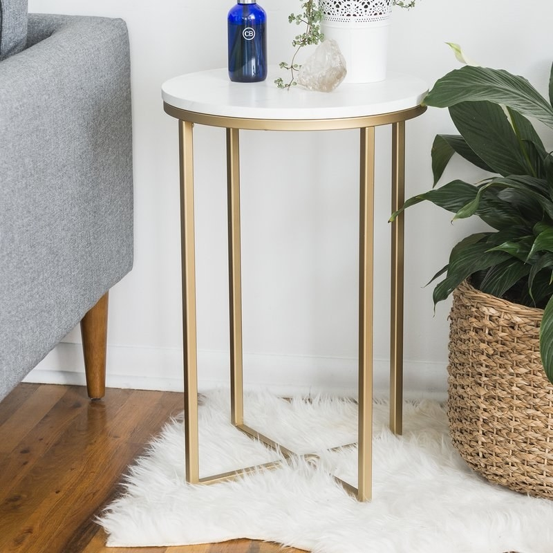 """Promising review: """"Love this side table! It has a great marble look, sleek gold finish, and took less than 10 minutes to assemble! It came in 24 hours and it's beautiful."""" —TiaraPrice: $59.41 (originally $189)"""