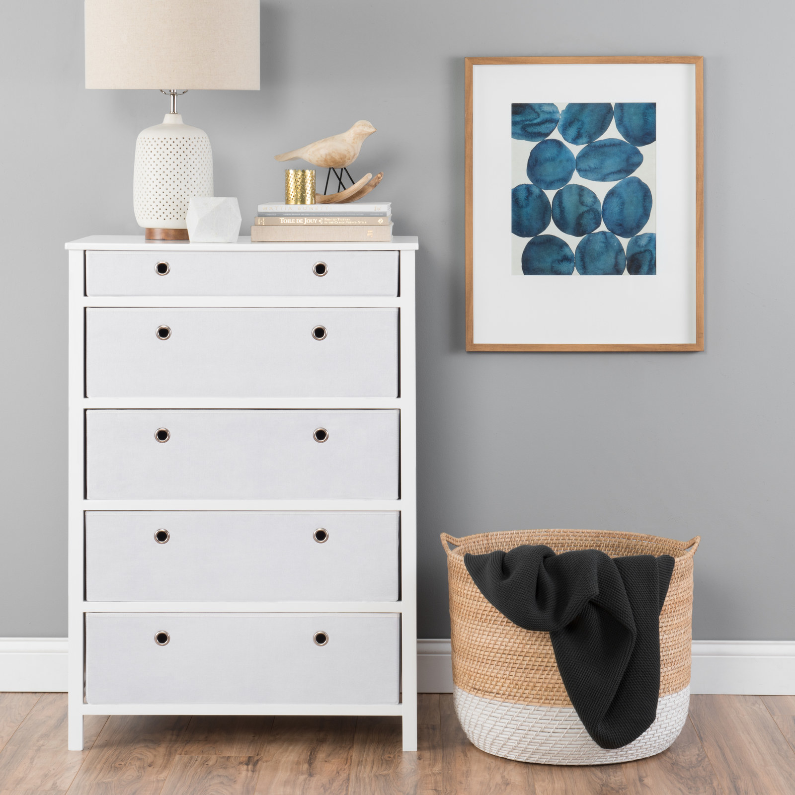 """Promising review: """"This dresser has a pretty neat design. It's foldable so it's easy to transport and I could easily fit it in my tiny two-door car to get it home. It's not all too heavy to carry upstairs either. I was mostly suspicious about the fabric dresser drawers because I thought they were going to be too flimsy, but they are actually quite substantial and I'm not concerned about them falling apart. Basically this is an easy dresser that looks really cute, too!"""" —BootsForBoopersPrice: $166.25+ (available in two colors)"""