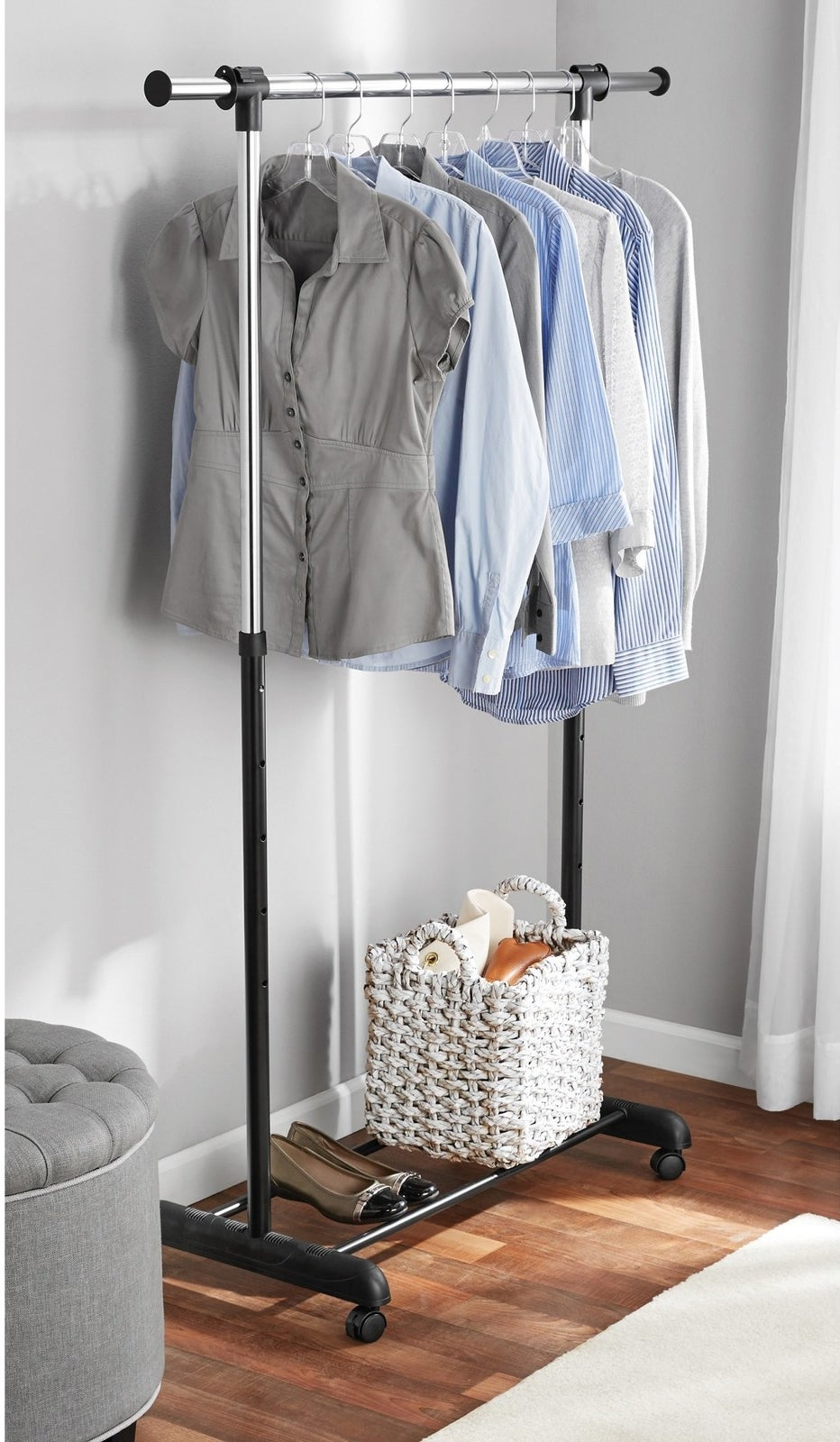 """Promising review: """"These racks are perfect for a studio apartment. If you are worried about your clothes being heavy, DON'T WORRY. I bought two and connected them together and they are AMAZING!! I have 27 sweatshirts/jackets, 73 t-shirts, and 12 sweaters/dresses. I also have purses and belts hanging on the ends. The bar at the top is completely straight even with all the weight. They were also very easy to put together. Its also very helpful that they can be shorter and taller, perfect for someone with a slanted ceiling."""" —RachadlPrice: $12.21"""