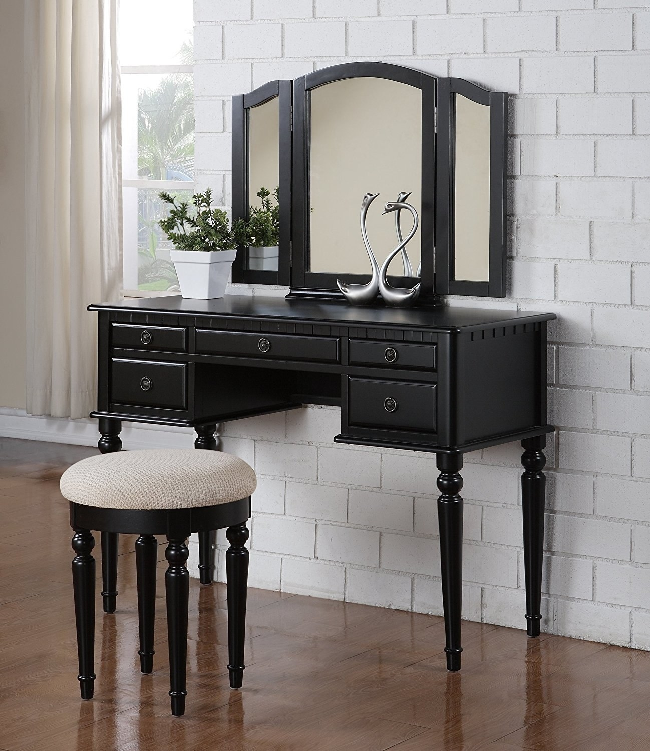 """Promising review: """"I just bought this for my 17-year old daughter and we both LOVE it! It's just the perfect size for her. The quality is top notch. It was packaged extremely well. We had no problems with dents, scratches or missing pieces. VERY easy to assemble. The desk and drawers are one piece. All you have to do is screw in the legs and attach the mirror to the back. Very simple. The chair is a nice size and very sturdy. I am very, very impressed. Great purchase and I recommend this vanity set."""" —ChristinaPrice: $239.04 (available in three colors)"""