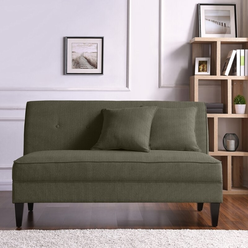 The loveseat comes with two throw pillows. Price: $285.99 (originally $975.10, available in 13 colors)