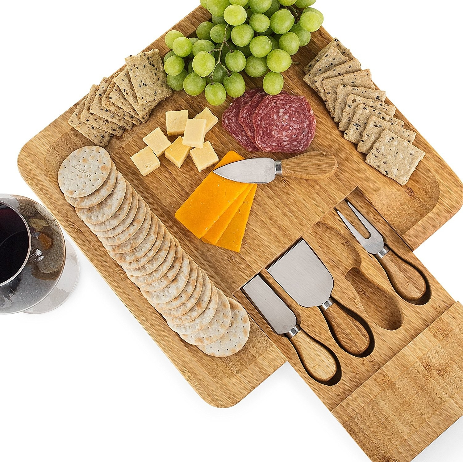 "Includes four stainless steel serving knives. Promising review: ""An excellent cheese board made of high-quality bamboo material. The finish is smooth and beautiful, and the drawer opens and closes smoothly but tightly. My boomer daughter says it's 'cool.' Highly recommended."" —Eric SandbaggerPrice: $29.99"