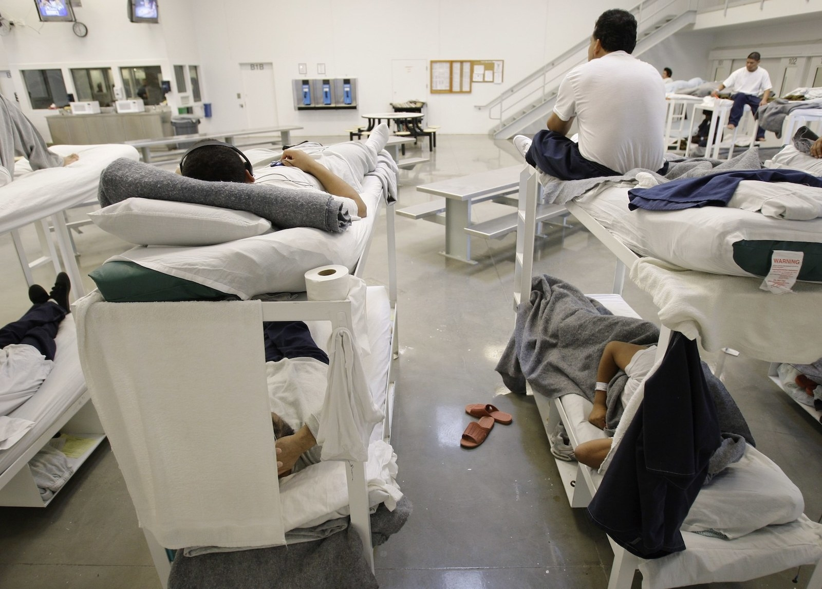 Detainees are shown resting on bunks inside the Northwest Detention Center in Tacoma, Washington.