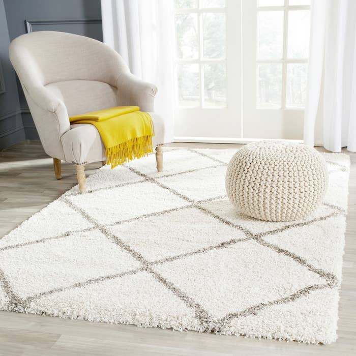 """Promising review: """"I can't believe the price. It looks much more expensive than it is. The colors are true to the picture (I bought the ivory/gray). It's also really plush, which is a nice change for me. It's in a room that doesn't get much traffic, but the quality seems excellent."""" —MchachaPrice: $44.99 (size 3' X 5')"""