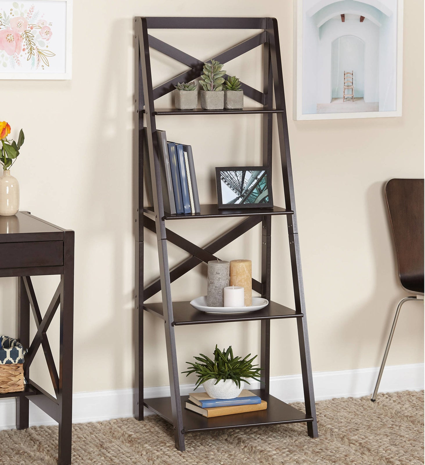 """Promising review: """"Purchased this to complement my bedroom/office. Blends well with my bedroom set and desk. Shelves are wide enough to place a printer on as well as photos. The cross-back designs gives some added flair to the piece"""" —HiVintagePrice: $54+ (available in three colors)"""