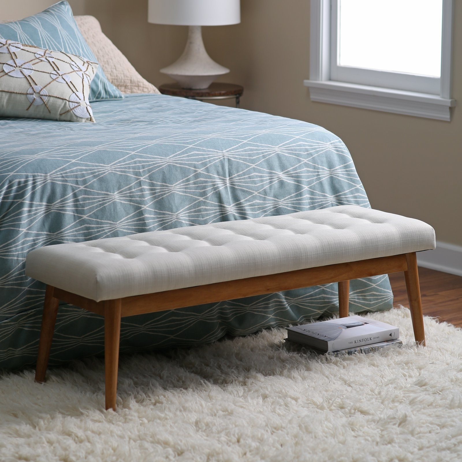 """Promising review: """"We have a really tall bed, so I needed a nice bench so that it would be easier to get my socks on in the morning. This fit the bill perfectly and was a great price. The bench is very solid and looks very nice in our bedroom. Came quickly and was easy to assemble."""" —AnnPrice: $155.69"""