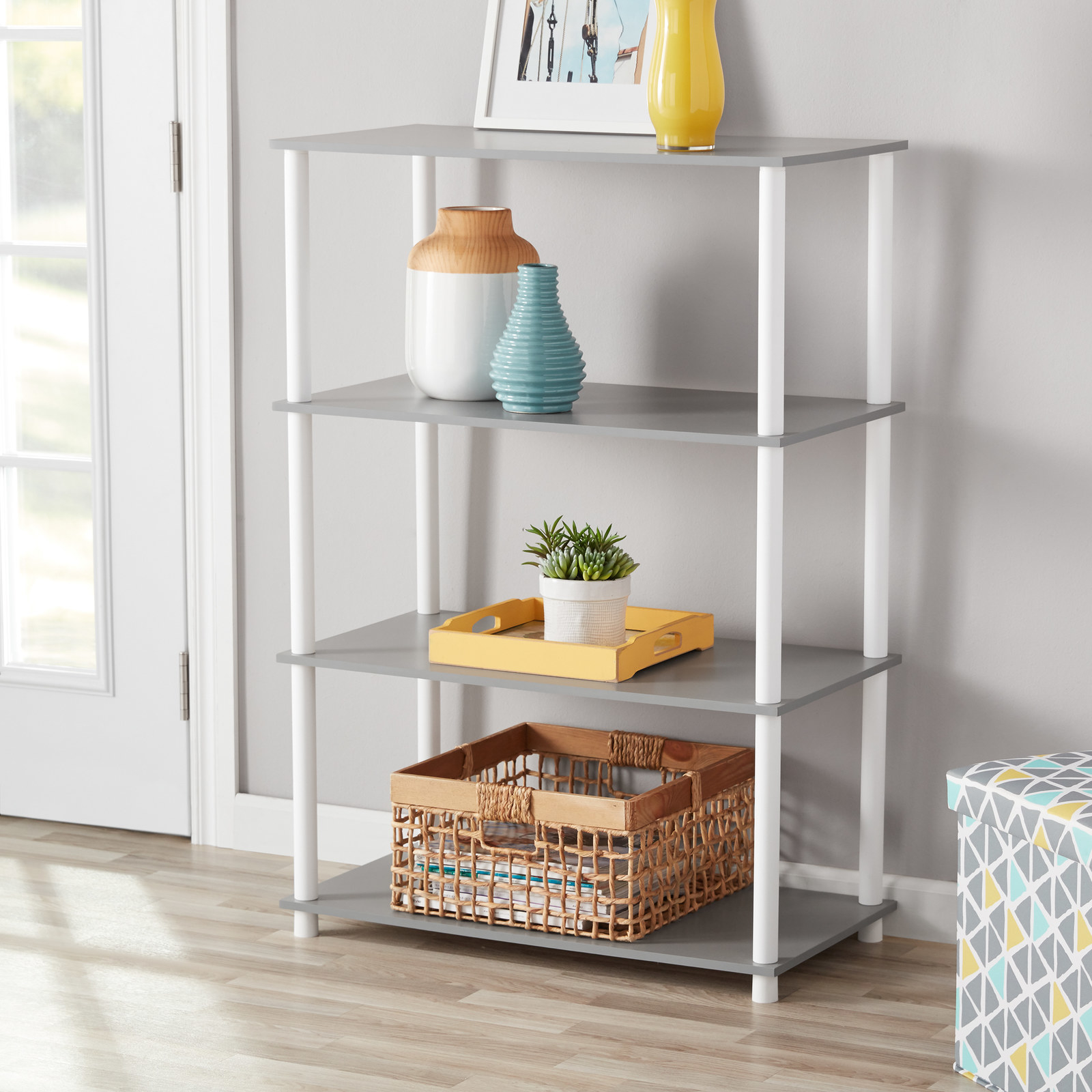 """Promising review: """"I love these shelves! I bought a set for my young son's room about two years ago to keep all his sporting equipment on. It is still holding up perfectly, so when I remodeled both my kids' bedrooms last month, I bought two more. I keep one in my son's closet to keep his stuff organized. They are perfect for a single mom because they are SUPER easy to put together. NO TOOLS! All the parts just screw into each other and for being plastic, they hold up well. My daughter put hers together herself. And you CANNOT BEAT THE PRICE! Love these!! I even bought the matching side tables."""" —MonicaMPrice: $19.88+ (available in five colors)"""
