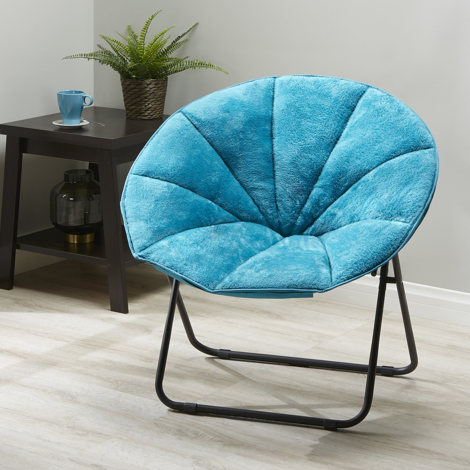 """Promising review: """"Purchased this chair for my son's dorm. Works great; it's comfortable and nice that it can fold up if needed to be set aside. Good price too!"""" —AEnglishPrice: $29 (available in three colors)"""