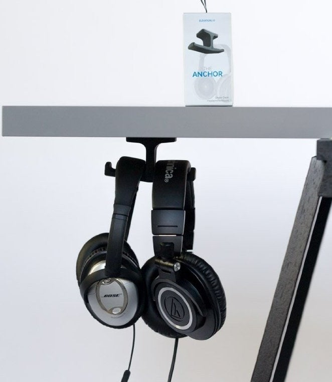"""This mount is also SUPER easy to apply — just remove the protective layer over the adhesive, stick it underneath your desk (it works on glass, hard plastic, metal, and finished wood), and BAM! Installation is complete. Promising review: """"This headphone stand is great. I have two relatively heavy headphones that I hang under my desk at work, and this holds both of them without any issues. Helps keep my desk clear, fewer wires to deal with, and it's a good hiding technique, too."""" —Rachel V. Get it from Amazon for $11.95."""