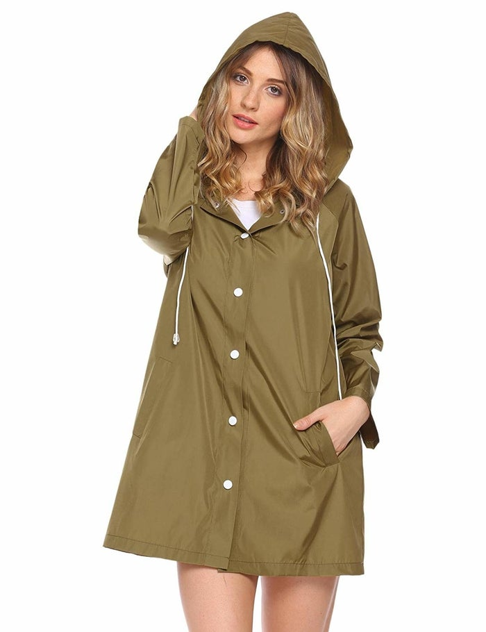 """Promising review: """"I bought this raincoat in both small and medium to see which one fit best. I'm 5'9"""", 125 lbs., and wear a size 2 or 4 in women's when it comes to shirts/coats. Overall, the medium fit best. I was able to wear a hoodie/sweater under the small (and button it up, too!), but my problem was the arm length. The arm length of the medium was great —it goes about an inch past my watch/wrist. I've worn the raincoat out on several rainy days (not heavy/flooding rain) and it worked great, kept me dry."""" —LinsaGet it from Amazon for $15.99+ (available in sizes S-2XL and in 10 colors)."""