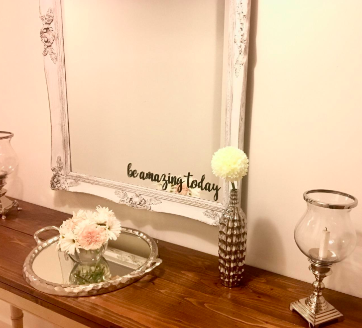 A customer review photo of the vinyl on their mirror