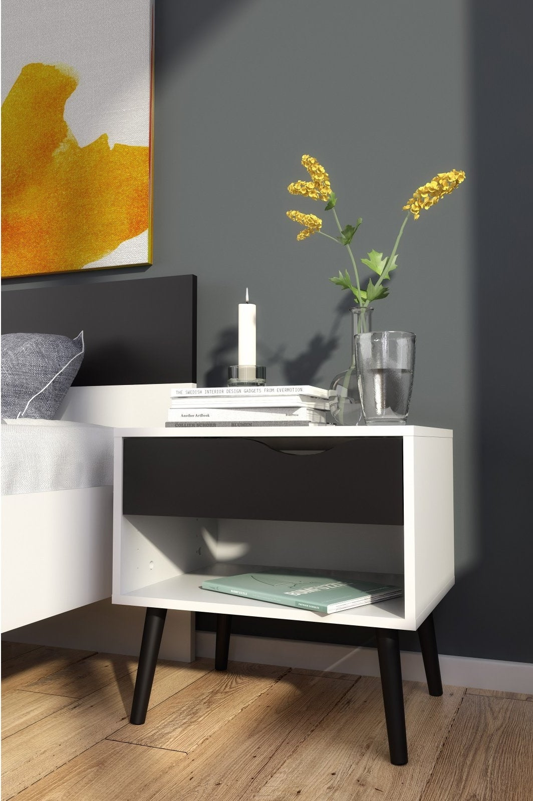"""Promising review: """"I could not be happier with this nightstand. My son's bed is very low to the ground and we struggled to find something that was the right height. This worked perfectly. It's actually very high quality for the price. The drawer is deep enough to fit a lot of his stuff in and the shelf is great for books at night."""" —AmyPrice: $59.40 (available in two colors)"""