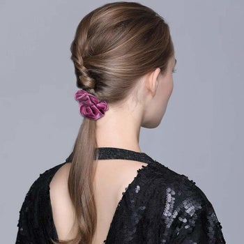 a model with a velvet scrunchie in their hair
