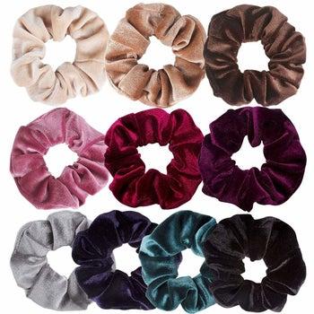 an array of colored velvet scrunchies