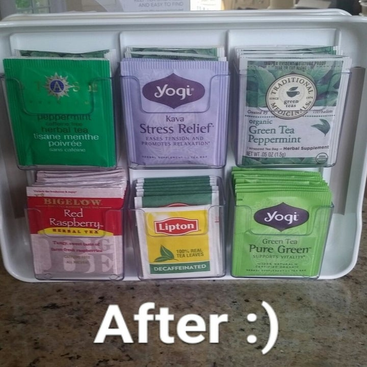 The same reviewer showing individual tea bags neatly placed inside clear bins in the organizer