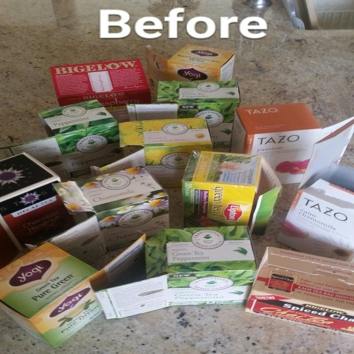 A reviewer showing various tea boxes strewn across their counter