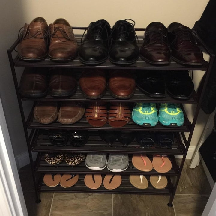shoes neatly arranged on two 3-tiered racks stacked on top of each other