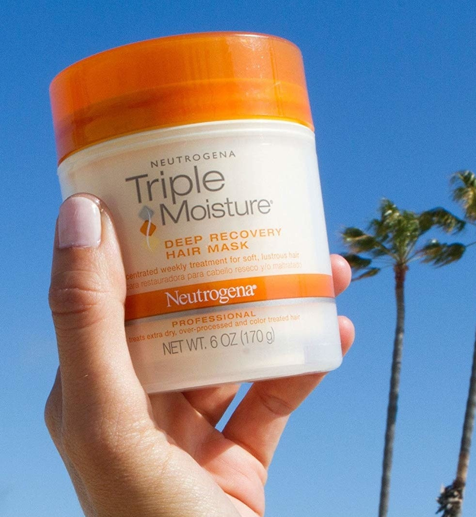 """This mask uses a magical blend of olive, meadowfoam, and sweet almond extracts to really lock moisture into each strand of hair. Promising review: """"This is a miracle product. My hair was so dry and crunchy, and my blond ends looked and felt completely fried and dead. I was about to go to my hairdresser to either get more hair cut off (it's already pretty short) or ask for a professional conditioning treatment. As a last resort DIY effort, I purchased this product based on stellar reviews and I'm so glad I did! This saved me at least $70 at the salon. After just ONE time using this, my hair has been transformed. It is now soft, shiny, and smooth. I hope this magical and affordable conditioner stays around forever!"""" —Amazon CustomerGet it from Amazon for $12.62."""