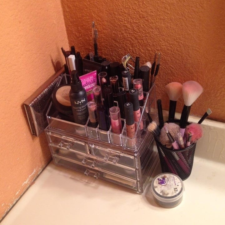 everything neatly organized in organizer with shelves and areas for brushes
