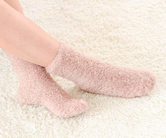 a pair of pink feathery soft socks