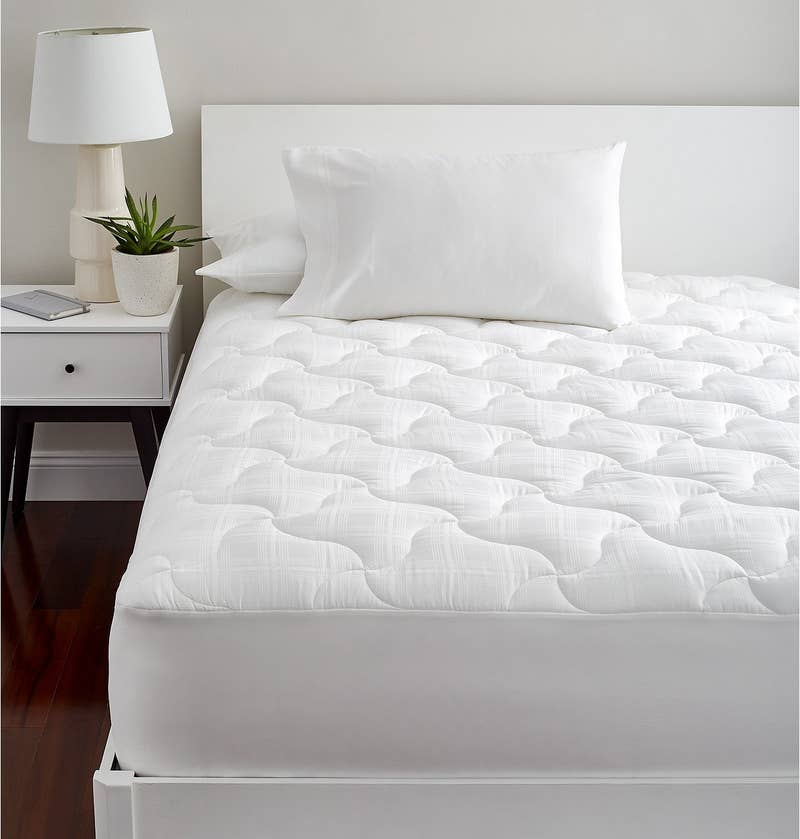 """It'll pull moisture away from you, leaving you dry and cool all year long. Promising review: """"I really like this mattress pad. It's my favorite mattress pad of all the ones I have ever purchased. I had just bought a new mattress and it was a little on the firm side. This mattress pad made my mattress very comfortable. The pad is substantial enough to add a layer of comfort, but it is not crazy thick. It is stays cool while sleeping. Lastly, the pockets are really deep so they fit well and it makes the pad really easy to put on the mattress."""" —WendygoGet it from BuzzFeed's Goodful line, sold exclusively at Macy's for $51.99+ (originally $90, use code PRES for an additional 20% off, available in sizes twin—Cal king)."""