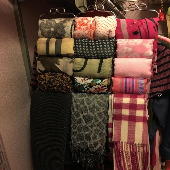 The scarves hanging in columns on the organizer
