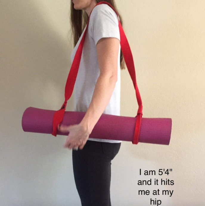 """Promising review: """"This is SO handy. I wish I had bought it sooner! It makes storing and transporting my mat way, way easier, and the strap itself is wide and doesn't hurt my shoulder."""" —Sarah Marie Get it from Amazon for $5.69+ (available in five colors and two sizes)."""