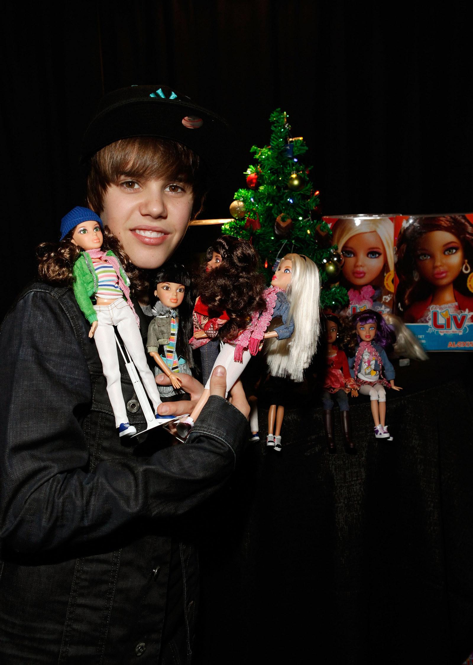 Justin Bieber and some Bratz Dolls.