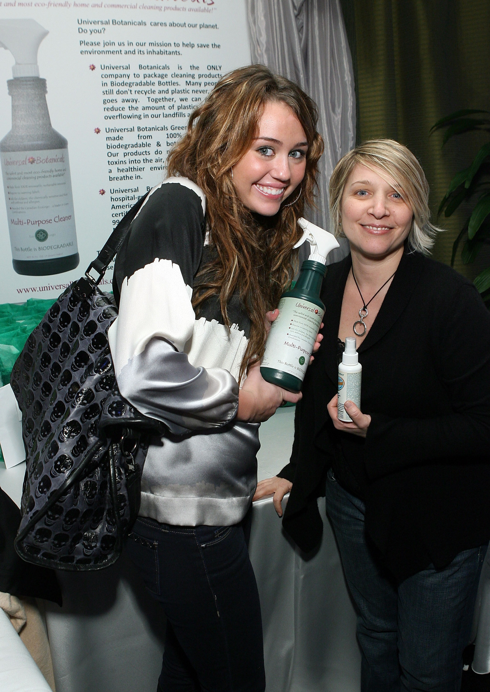 Miley Cyrus and a bottle of spray cleaner.