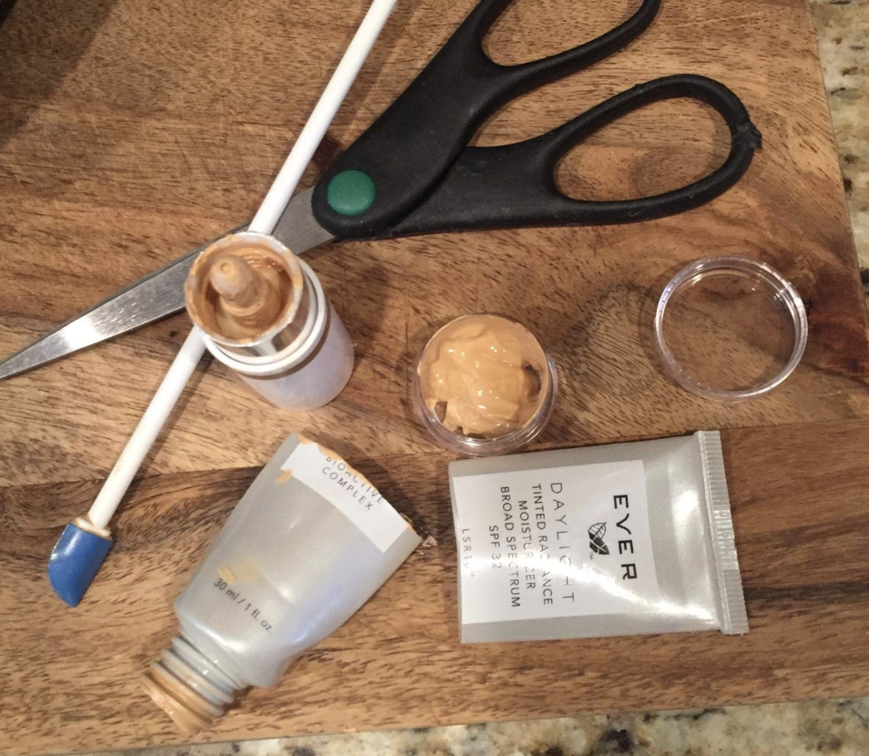 A reviewer showing extra makeup removed from the tub using the spatula