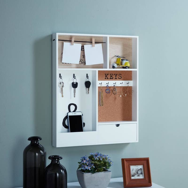 """Promising review: """"The decorative organizer is cleverly designed to hold plenty of keys, mail, and clothes pins for notes. A small drawer adds a nice touch for things out of view. You will need to allocate a spacious area on your wall away from other hanging items to do it justice. The organizer is heavy, so I suggest you secure it with the appropriate nails."""" —T01Get it from The Home Depot for $55.95."""