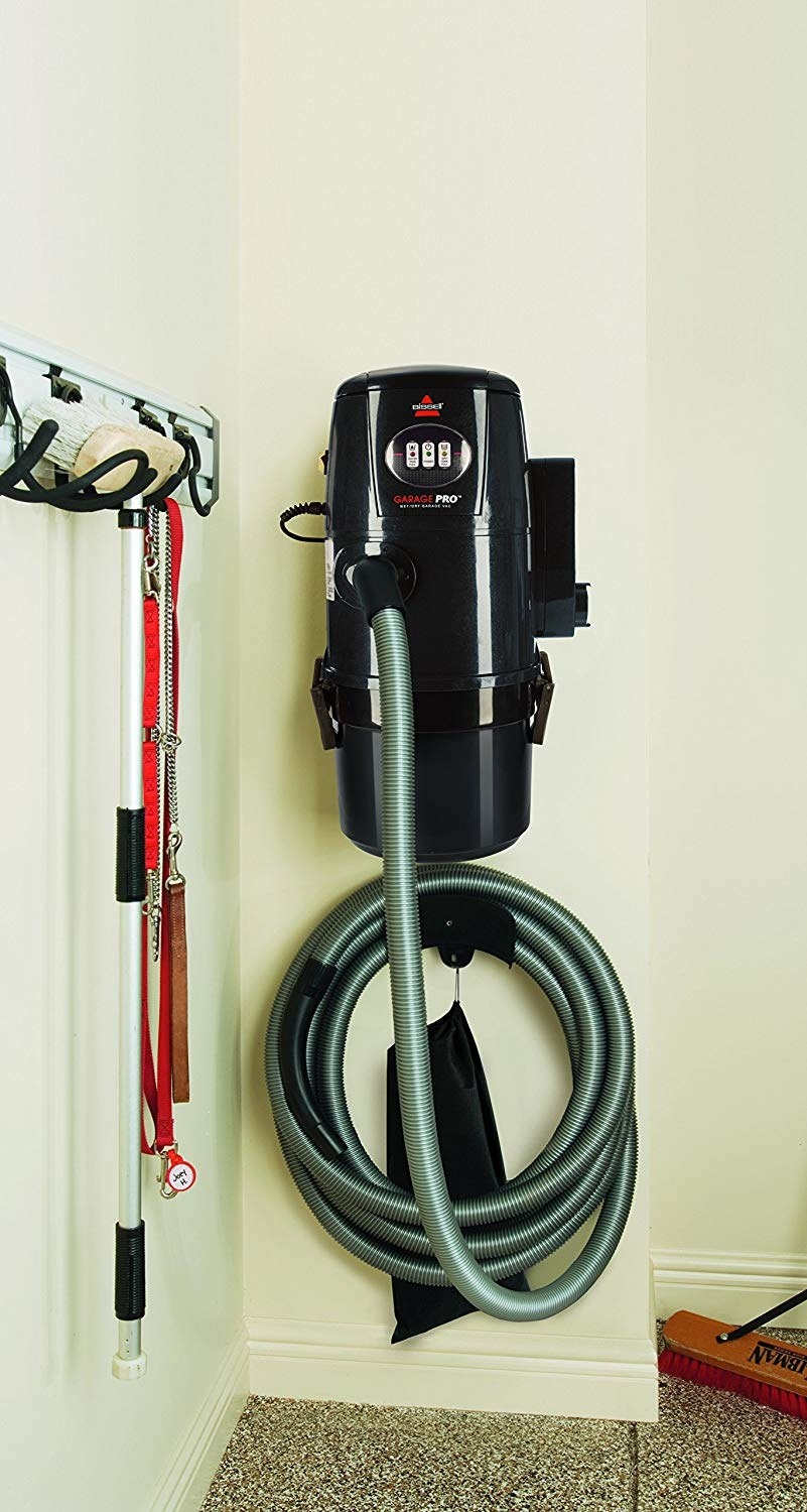 the wet dry vac hanging on a wall