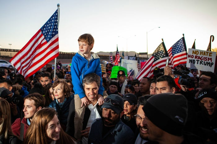 Beto O'Rourke carries his son Henry O'Rourke on his shoulders as they march along the US–Mexico border in protest of President Donald Trump's proposed border wall on Feb. 11 in El Paso, Texas.