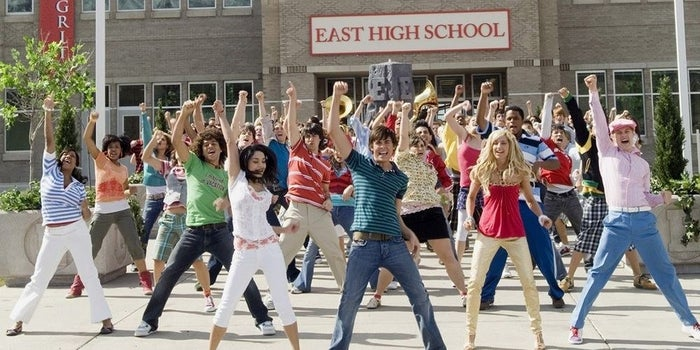 High School Musical: The Musical takes place at East High (go Wildcats!) 15 years after the original movie aired and follows the (new) theater kids as they experience blossoming show-mances and flaring rivalries. The drama! The meta-ness!