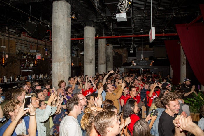 Julia Salazar supporters cheer at the sight of election results moments before Salazar won her 2018 Democratic primary.