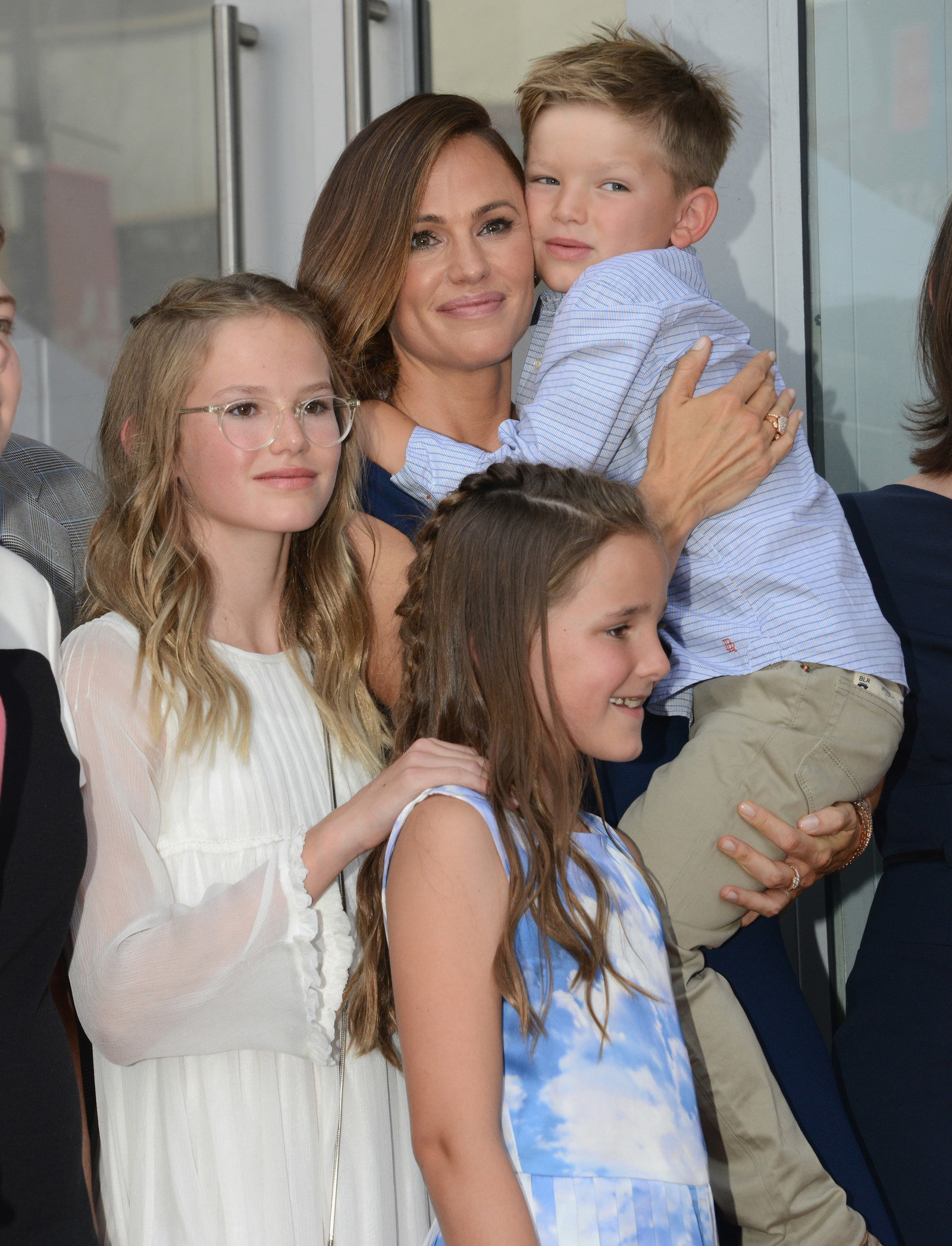 Ben was taking his three children — Violet, Seraphina, and Samuel — to a Red Sox game. -  Here they are pictured with their mama at her Walk of Fame ceremony.