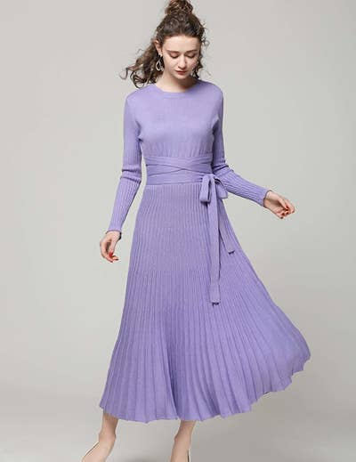 42ccc84d290e9 A decadent cashmere swing dress designed with an elegant pleated skirt and  a wraparound belt that ll complete the look.