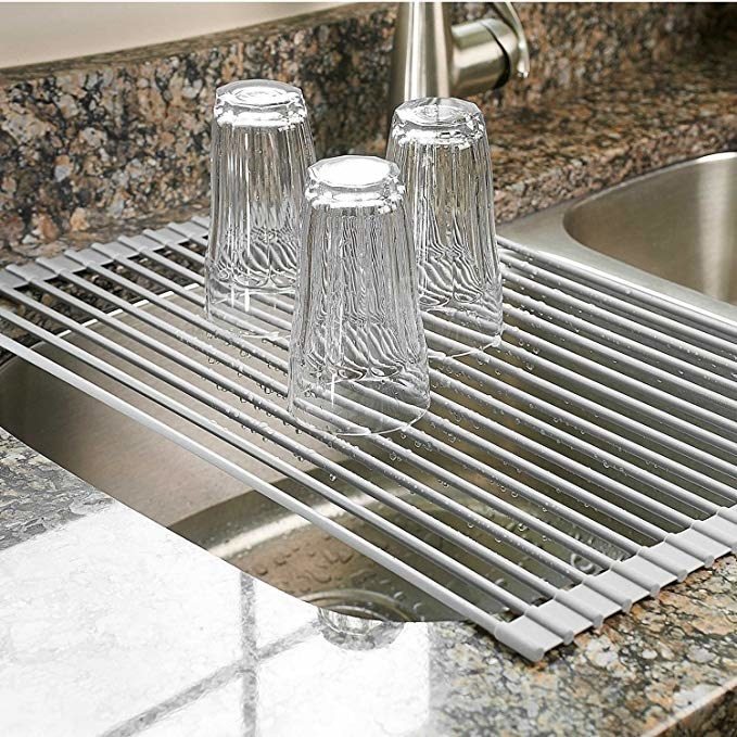 A drying rack placed over the sink with cups on top. The rack can easily break down and fold up for convenient storage.