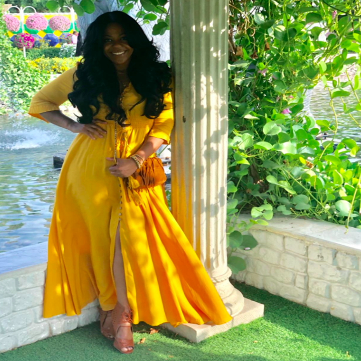 A customer review photo of the yellow dress