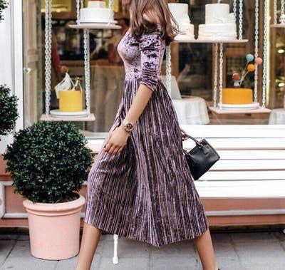 a875c443521 A pleated velvet off-the-shoulder midi dress to wear through every season —  but go ahead and use February as your excuse to buy it.