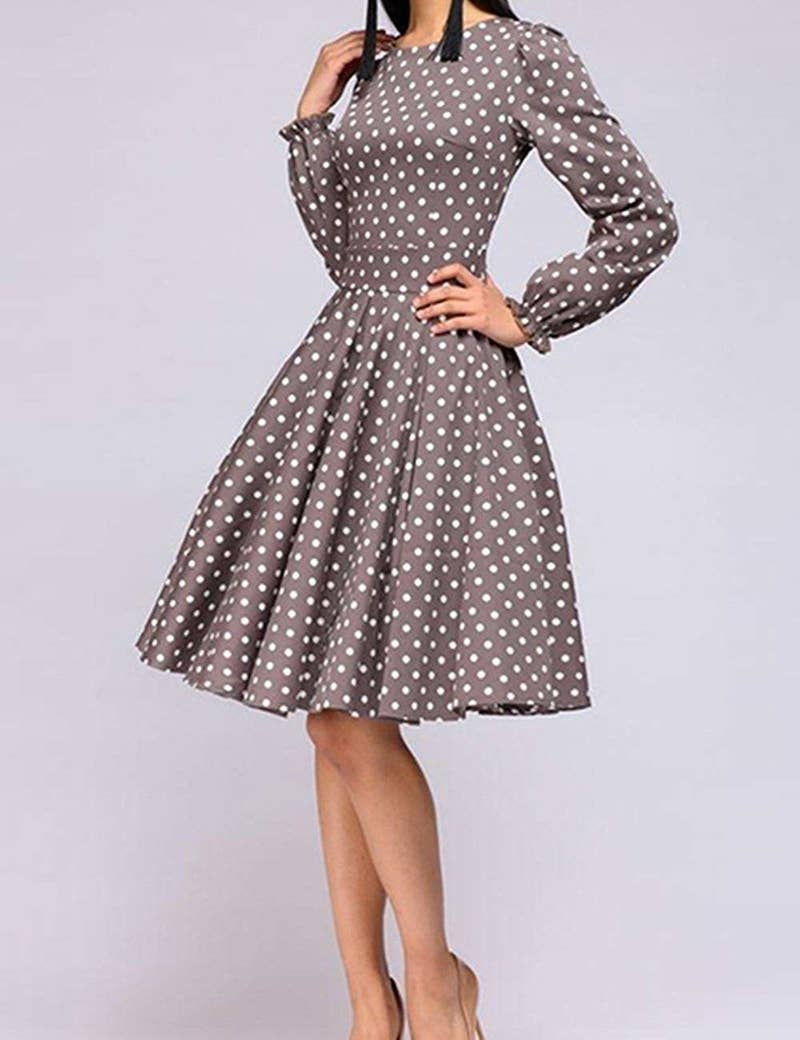 "Promising review: ""The measurement chart for this dress appears to be accurate. (Hooray!) I typically wear a medium/large. Following the measurement chart provided, I opted for the large. It has a lovely fit without being too roomy. The material is very thin and very synthetic. It still looks pretty and fun with the polka dots, so I don't mind. (Even though the material is quite thin, it doesn't appear to be see-through.) The fit and flare at the waist is lovely, and I also think the long sleeves are beautifully cut. The sleeves have elastic at the wrist, so you can wear them up or down. I also appreciate that this dress has a back zipper since tugging dresses over my head is not a fun process."" —IrishCoffeeGet it from Amazon for $20.99+ (available in sizes S-2XL)."