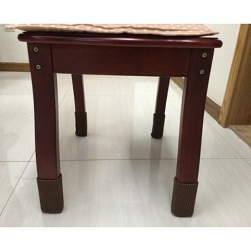 the brown furniture legs on a table