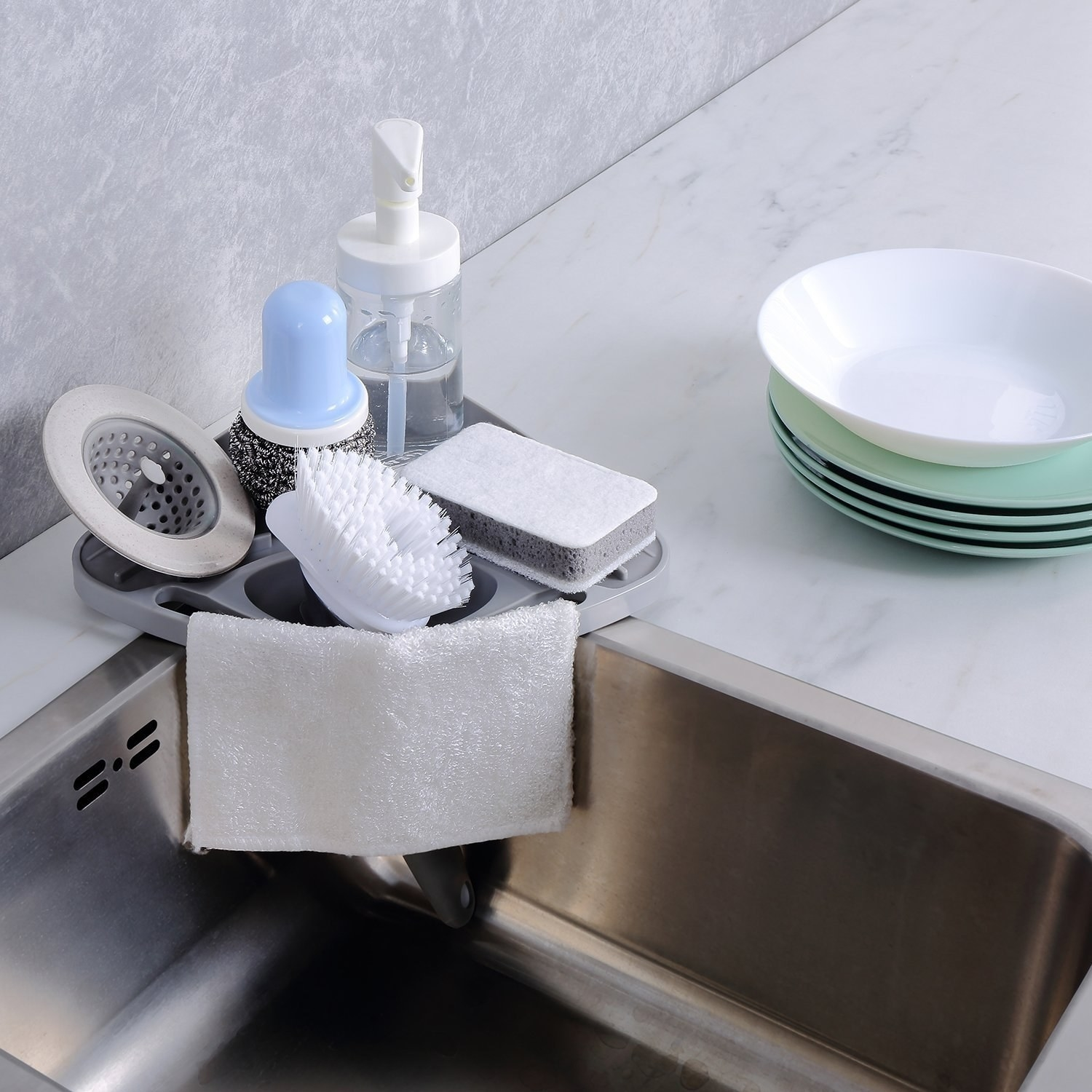 A corner caddy that slips into the corner of sink, with part of it able to drain into the sink
