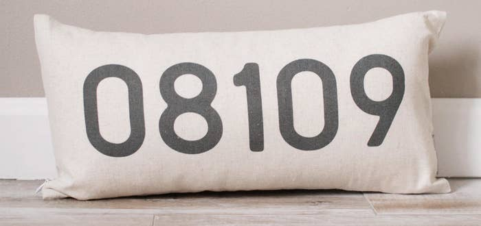 the throw pillow with a zip code on it