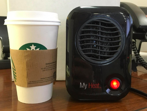 """This 200-watt heater is just a little taller than six inches (about as tall as a grande Starbucks cup) and will provide you maximum heat. Reviewers say it is extremely quiet, so you barely know that it's on!Promising review: """"I bought this heater two years ago and it is STILL perfect. It's traveled with me to a few homes, and I always put it under my desk to warm my feet. It is so quiet that nobody even knows I have it unless I tell them. The heat that comes out is very fast, strong, and localized to a small area. Perfect for under my desk, and probably would be great on top of a desk if your arms/body get cold too."""" —KathrynGet it from Amazon for $19.99+ (available in four colors)."""