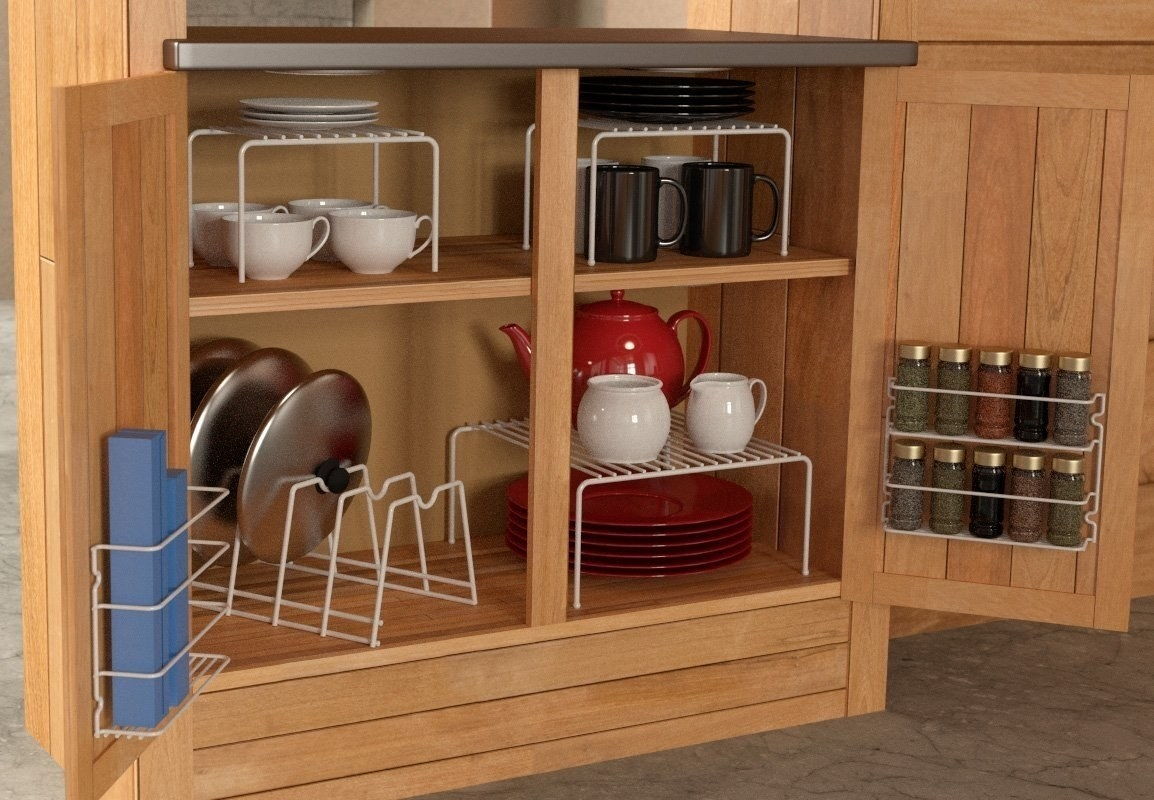A cabinet organizer set with different racks for organizing dishes, pot lids, spices, and baggies