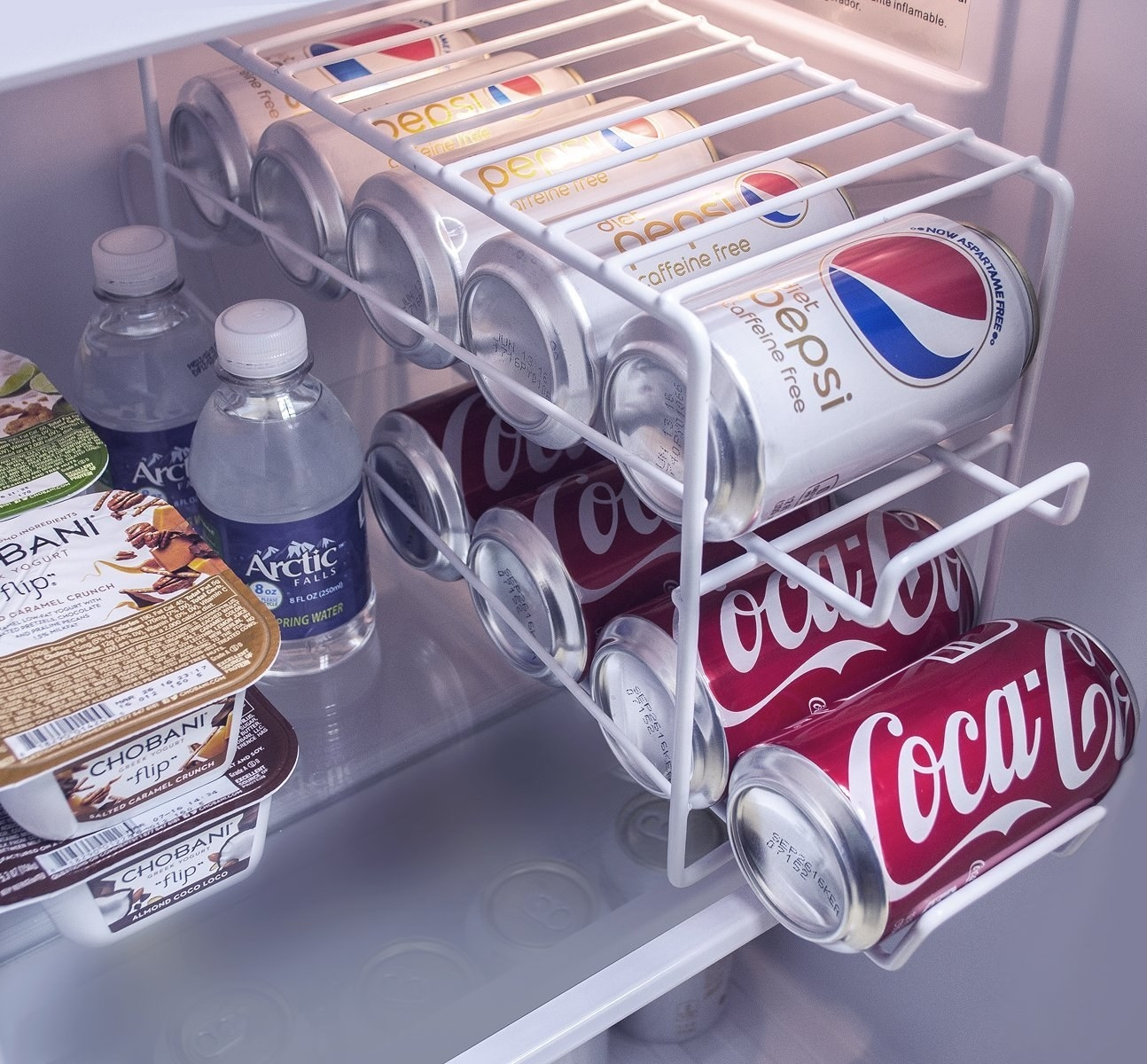 Soda can rack placed in fridge to easily organizer cans, There are two tiers so it can fit 12 cans